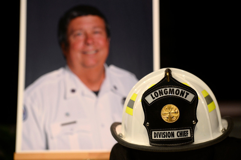 A photo of retired Longmont firefighter and his helmet Lynn Huff Friday morning Feb. 15, 2013 at LifeBridge Christian Church. (Lewis Geyer/Times-Call)