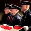 Longmont Police Department Color Guard fold the American flag during the funeral of retired Longmont firefighter Lynn Huff Friday morning Feb. 15, 2013 at LifeBridge Christian Church before presenting it to Huff's wife Barbara. (Lewis Geyer/Times-Call)