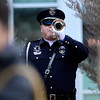 Longmont Police Department Honor Guard member Tim Lambert plays Taps at the funeral of retired Longmont firefighter Lynn Huff Friday morning Feb. 15, 2013 at LifeBridge Christian Church. (Lewis Geyer/Times-Call)