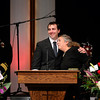 Retired Longmont firefighter Lynn Huff's son Christopher Huff, left, and wife Barbara Huff, right, hug while speaking at his funeral Friday morning Feb. 15, 2013 at LifeBridge Christian Church.<br /> (Lewis Geyer/Times-Call)