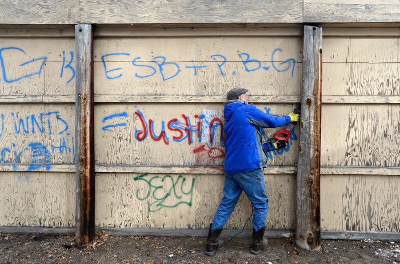 "Robert Poysti cuts a wall away from its support in Longmont on Monday, Dec. 24, 2012. The opposite side of the wall contains a mural painted by Gamma Acosta as a tribute to Sandy Hook. The wall is being cut out to preserve the artwork. For more photos and a video visit  <a href=""http://www.TimesCall.com"">http://www.TimesCall.com</a>.<br /> (Greg Lindstrom/Times-Call)"