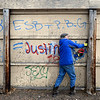 """Robert Poysti cuts a wall away from its support in Longmont on Monday, Dec. 24, 2012. The opposite side of the wall contains a mural painted by Gamma Acosta as a tribute to Sandy Hook. The wall is being cut out to preserve the artwork. For more photos and a video visit  <a href=""""http://www.TimesCall.com"""">http://www.TimesCall.com</a>.<br /> (Greg Lindstrom/Times-Call)"""
