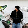 "Gamma Acosta braces his mural ""Crayons,"" Dec. 24, 2012, a tribute to Sandy Hook. The wall is being cut out to preserve the artwork. For more photos and a video visit  <a href=""http://www.TimesCall.com"">http://www.TimesCall.com</a>.<br /> (Greg Lindstrom/Times-Call)"