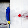 """Robert Poysti holds a wall Monday, Dec. 24, 2012, containing a mural painted by Gamma Acosta as a tribute to Sandy Hook. The wall is being cut out to preserve the artwork. For more photos and a video visit  <a href=""""http://www.TimesCall.com"""">http://www.TimesCall.com</a>.<br /> (Greg Lindstrom/Times-Call)"""