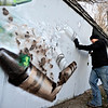 """Gamma Acosta braces his mural """"Crayons,"""" Dec. 24, 2012, a tribute to Sandy Hook. The wall is being cut out to preserve the artwork. For more photos and a video visit  <a href=""""http://www.TimesCall.com"""">http://www.TimesCall.com</a>.<br /> (Greg Lindstrom/Times-Call)"""
