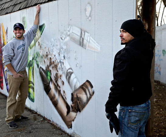 "Gamma Acosta, right, and his brother Lorenzo hold a wall Monday, Dec. 24, 2012, containing a mural painted by Gamma Acosta as a tribute to Sandy Hook. The wall is being cut out to preserve the artwork. For more photos and a video visit  <a href=""http://www.TimesCall.com"">http://www.TimesCall.com</a>.<br /> (Greg Lindstrom/Times-Call)"