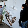 """Gamma Acosta, right, and his brother Lorenzo hold a wall Monday, Dec. 24, 2012, containing a mural painted by Gamma Acosta as a tribute to Sandy Hook. The wall is being cut out to preserve the artwork. For more photos and a video visit  <a href=""""http://www.TimesCall.com"""">http://www.TimesCall.com</a>.<br /> (Greg Lindstrom/Times-Call)"""
