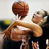 "Shining Mountain's Hannah Weinstein (12) is fouled by Gilpin County's Alyssa Chareunsouk during the game at Shining Mountain Waldorf School on Thursday, Feb. 14, 2013. Gilpin County beat Shining Mountain 34-23. For more photos visit  <a href=""http://www.BoCoPreps.com"">http://www.BoCoPreps.com</a>.<br /> (Greg Lindstrom/Times-Call)"