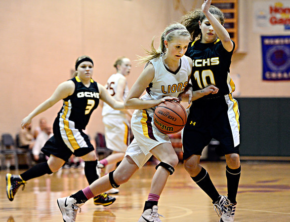 "Shining Mountain's Hana Mason is pressured by Gilpin County's Khristine Barr (10) during the game at Shining Mountain Waldorf School on Thursday, Feb. 14, 2013. Gilpin County beat Shining Mountain 34-23. For more photos visit  <a href=""http://www.BoCoPreps.com"">http://www.BoCoPreps.com</a>.<br /> (Greg Lindstrom/Times-Call)"