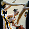 "Shining Mountain's Paisley Sheehan looks for an opening in the Gilpin County defense during the game at Shining Mountain Waldorf School on Thursday, Feb. 14, 2013. Gilpin County beat Shining Mountain 34-23. For more photos visit  <a href=""http://www.BoCoPreps.com"">http://www.BoCoPreps.com</a>.<br /> (Greg Lindstrom/Times-Call)"