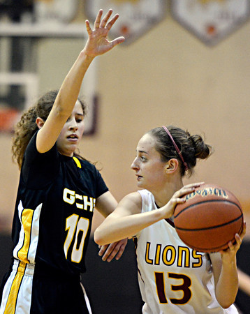 "Shining Mountain's Paisley Sheehan (13) is pressured by Gilpin County's Khristine Barr (10) during the game at Shining Mountain Waldorf School on Thursday, Feb. 14, 2013. Gilpin County beat Shining Mountain 34-23. For more photos visit  <a href=""http://www.BoCoPreps.com"">http://www.BoCoPreps.com</a>.<br /> (Greg Lindstrom/Times-Call)"