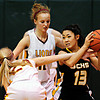 "Shining Mountain's Hana Mason (24) and Hannah Weinstein (12) defend Gilpin County's Alyssa Chareunsouk (13) during the game at Shining Mountain Waldorf School on Thursday, Feb. 14, 2013. Gilpin County beat Shining Mountain 34-23. For more photos visit  <a href=""http://www.BoCoPreps.com"">http://www.BoCoPreps.com</a>.<br /> (Greg Lindstrom/Times-Call)"