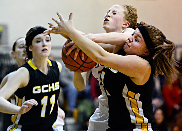 """Shining Mountain's Sarrah Claman, center, competes for a rebound against Gilpin County's Ashlen Cortez, right, and Katura Sales (11) during the game at Shining Mountain Waldorf School on Thursday, Feb. 14, 2013. Gilpin County beat Shining Mountain 34-23. For more photos visit  <a href=""""http://www.BoCoPreps.com"""">http://www.BoCoPreps.com</a>.<br /> (Greg Lindstrom/Times-Call)"""