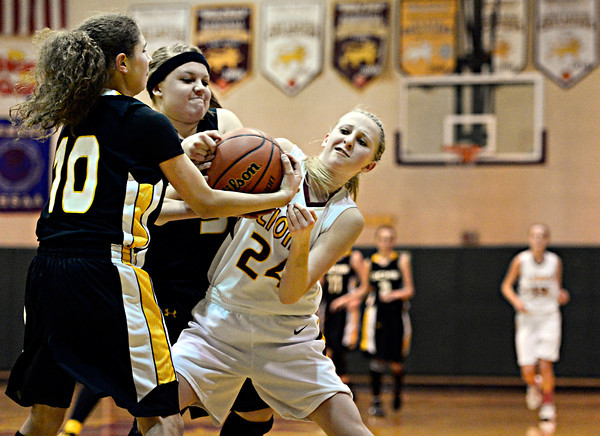 "Shining Mountain's Hana Mason (24) is pressured by Gilpin County's Khristine Barr (10) and Ashlen Cortez during the game at Shining Mountain Waldorf School on Thursday, Feb. 14, 2013. Gilpin County beat Shining Mountain 34-23. For more photos visit  <a href=""http://www.BoCoPreps.com"">http://www.BoCoPreps.com</a>.<br /> (Greg Lindstrom/Times-Call)"