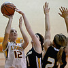 "Shining Mountain's Hannah Weinstein (12) tries to shoot over Gilpin County's Katura Sales (11) and Samantha Peterson (21) during the game at Shining Mountain Waldorf School on Thursday, Feb. 14, 2013. Gilpin County beat Shining Mountain 34-23. For more photos visit  <a href=""http://www.BoCoPreps.com"">http://www.BoCoPreps.com</a>.<br /> (Greg Lindstrom/Times-Call)"