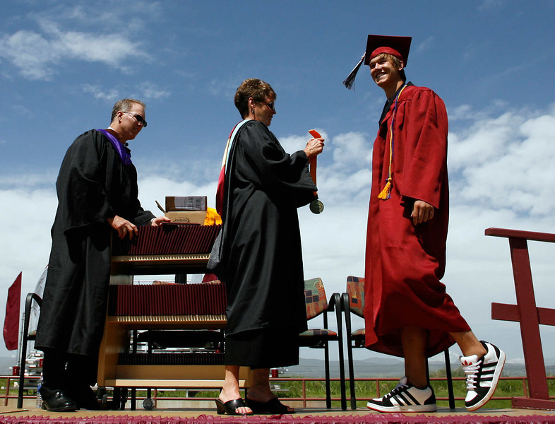 Silver Creek High School graduate Kevin Allman receives his diploma from Principal Sherri Schumann during the school's commencement ceremony, May 29, 2010.