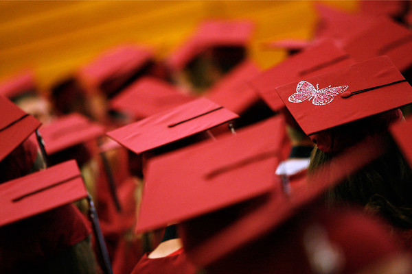 A butterfly adorns a cap as graduates assemble in the gymnasium at Silver Creek High School prior to their commencement ceremony, May 29, 2010.