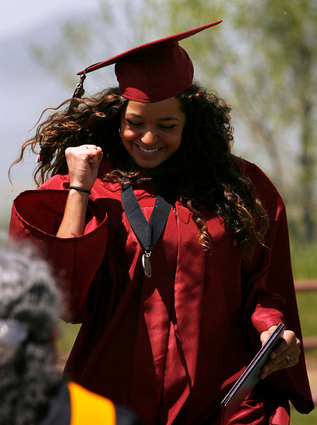Graduate Savana Meisner (cq) celebrates after receiving her diploma during the Silver Creek High School commencement ceremony, May 29, 2010.