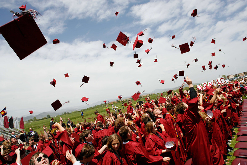 Graduates toss their caps into the air at the close of the Silver Creek High School commencement ceremony, May 29, 2010.
