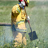 Mountain View Fire & Rescue personnel work to put out a brushfire near Union Resevoir just off of County Road 28 in Longmont, Thursday, June 27, 2013. (Kai Casey/Times-Call)