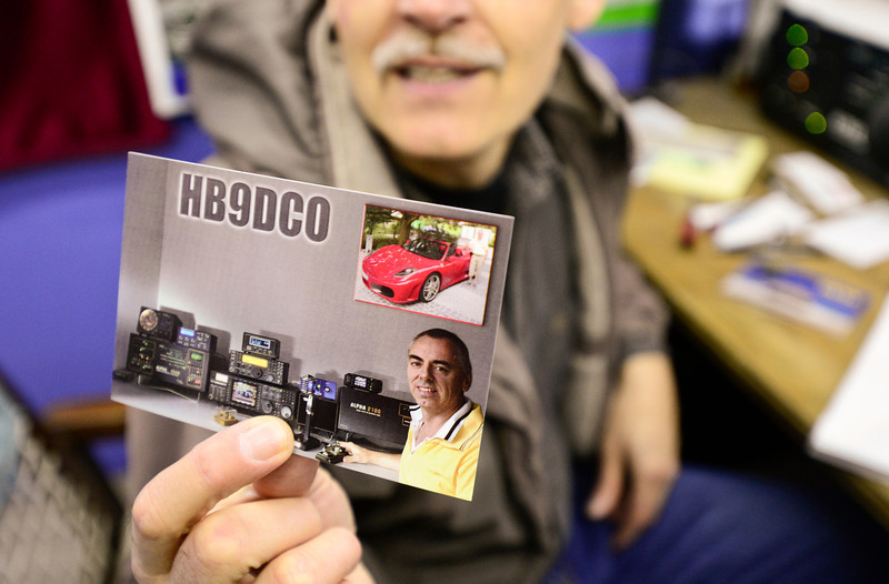 Sebastian Wessels, past president of the Longmont Amateur Radio Club, holds up a QSL Card from a radio operator in Switzerland that shows a Longmont made Alpha 9500 amplifier on the lower left, Tuesday, Jan. 15, 2013.<br /> (Matthew Jonas/AP PHOTO/Longmont Times-Call)