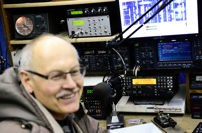 Sebastian Wessels, past president of the Longmont Amateur Radio Club, shares a laugh, Tuesday, Jan. 15, 2013, while talking about the etiquette of talking to other operators around the world.<br /> (Matthew Jonas/Times-Call)