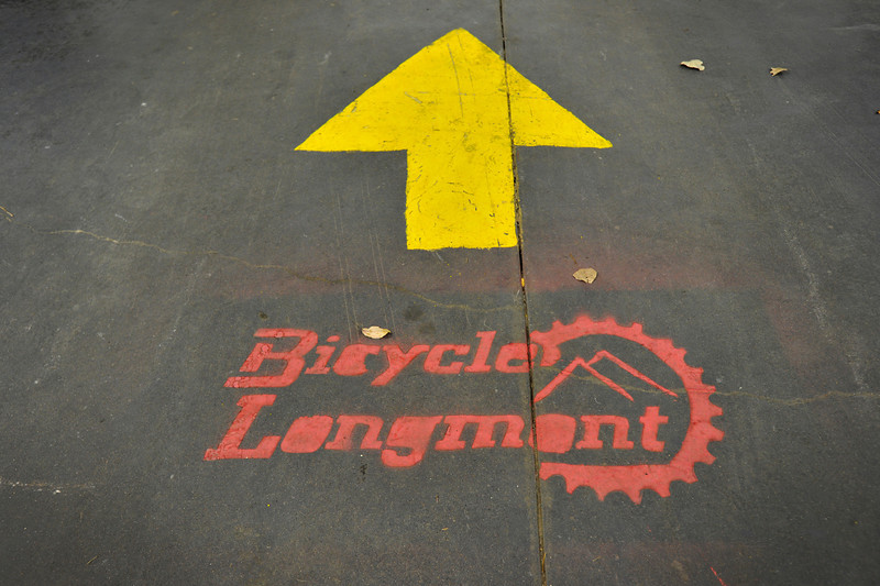 A Bicycle Longmont logo is seen on the ground, Wednesday, Nov. 28, 2012, at Bicycle Longmont's Bike Garage at Twin Peaks Mall.<br /> (Matthew Jonas/Times-Call)