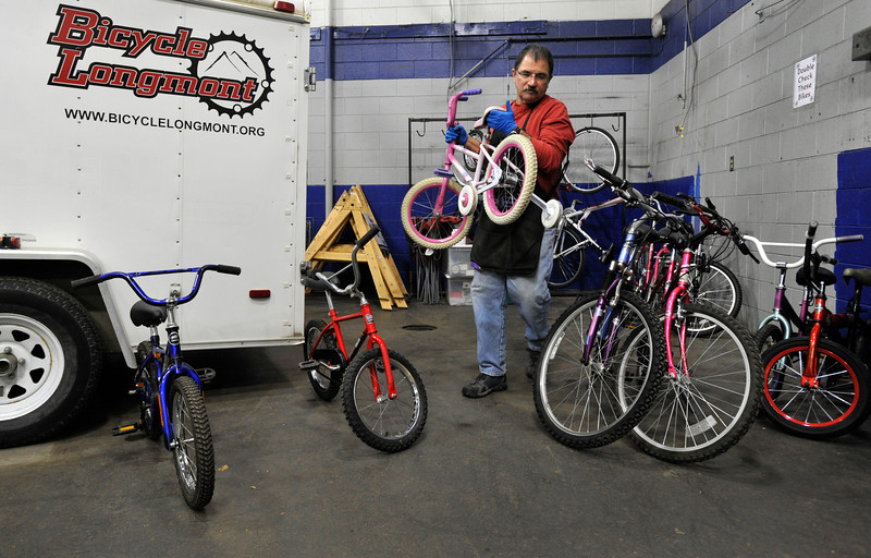 Bike Mechanic Buzz Feldman organizes bikes to be cleaned or fixed, Wednesday, Nov. 28, 2012, at Bicycle Longmont's Bike Garage at Twin Peaks Mall.<br /> (Matthew Jonas/Times-Call)