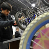 Charles Musgrave, Boy Scout Troop No. 360, works to install training wheels on a bike, Wednesday, Nov. 28, 2012, at Bicycle Longmont's Bike Garage at Twin Peaks Mall.<br /> (Matthew Jonas/Times-Call)