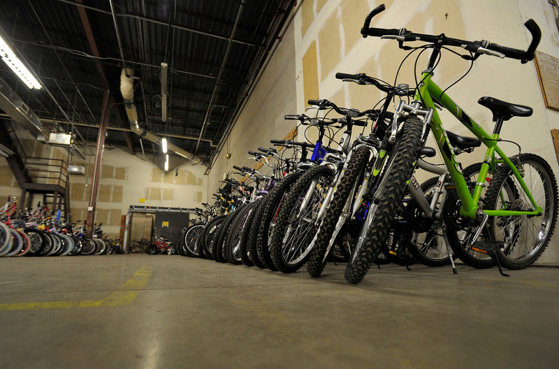 A row of larger 24 and 26 inch wheel bikes are seen, Wednesday, Nov. 28, 2012, at Bicycle Longmont's Bike Garage at Twin Peaks Mall. The program needs more 20 inch and smaller sized bikes to meet the current need.<br /> (Matthew Jonas/Times-Call)