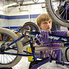 Porter Florence, Boy Scout Troop No. 360, works to clean the mud off a bike, Wednesday, Nov. 28, 2012, at Bicycle Longmont's Bike Garage at Twin Peaks Mall.<br /> (Matthew Jonas/Times-Call)