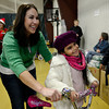 "Yaretzi Mares, 7, and volunteer Sandy Riddle pose for a photo with Yaretzi's new bike during the annual Y-Pals Holiday Party and Longmont Bicycle Giveaway at the Ed & Ruth Lehman YMCA, 950 Lashley St., Saturday Dec. 15, 2012. Nearly 580 bikes were collected through the annual holiday bike program sponsored by Bicycle Longmont. TO VIEW A VIDEO AND SLIDESHOW VISIT  <a href=""http://WWW.TIMESCALL.COM"">http://WWW.TIMESCALL.COM</a> (Lewis Geyer/Times-Call)"