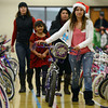 "Jessica Cavala helps Scarlett Leos, 7, with her new bike during the annual Y-Pals Holiday Party and Longmont Bicycle Giveaway at the Ed & Ruth Lehman YMCA, 950 Lashley St., Saturday Dec. 15, 2012. Nearly 580 bikes were collected through the annual holiday bike program sponsored by Bicycle Longmont. TO VIEW A VIDEO AND SLIDESHOW VISIT  <a href=""http://WWW.TIMESCALL.COM"">http://WWW.TIMESCALL.COM</a> (Lewis Geyer/Times-Call)"