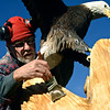"Lueb Popoff, of Hollow Log Tree Carving and Sculpture, puts a coat of Danish oil on an eagle carving in the yard at 631 Independence Dr. in Longmont on Monday, Jan. 7, 2013. For more photos and a video visit  <a href=""http://www.TimesCall.com"">http://www.TimesCall.com</a>. <br /> (Greg Lindstrom/Times-Call)"