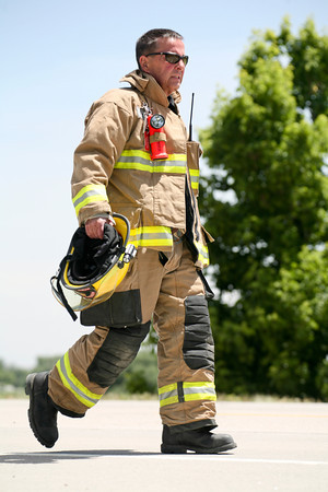 A firefighter investigates the scene after a two-car accident on State Highway 66 in front of the Greenwood Wildlife Rehabilitation Center in Longmont, Friday, June 28, 2013. (Kai Casey/Times-Call)