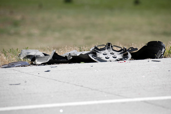 Remnants of a car sit on the side of the road after a two-car accident on State Highway 66 in front of the Greenwood Wildlife Rehabilitation Center in Longmont, Friday, June 28, 2013. (Kai Casey/Times-Call)
