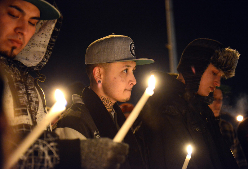 About 50 people attend a vigil for 16 year old Jason Grimmer Tuesday night Jan. 01, 2013. Grimmer died after being struck by a hit-and-run vehicle on North Main Street. (Lewis Geyer/Times-Call)