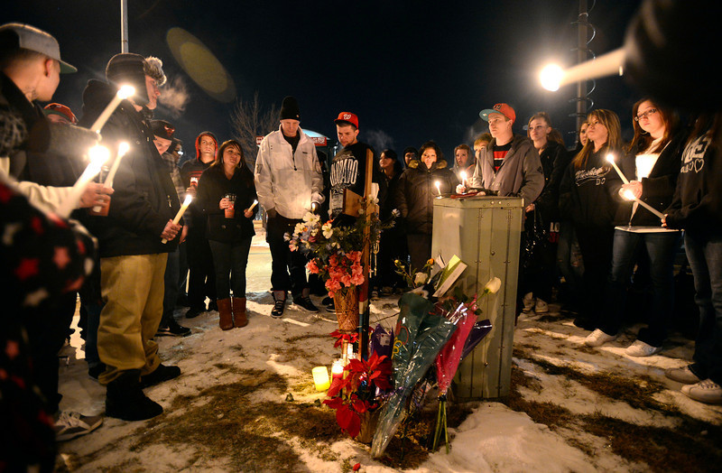 Fifty people attended a vigil for 16 year old Jason Grimmer Tuesday night, Jan. 1, 2013. Grimmer died after being struck by a hit-and-run vehicle on North Main Street. (Lewis Geyer/Times-Call)