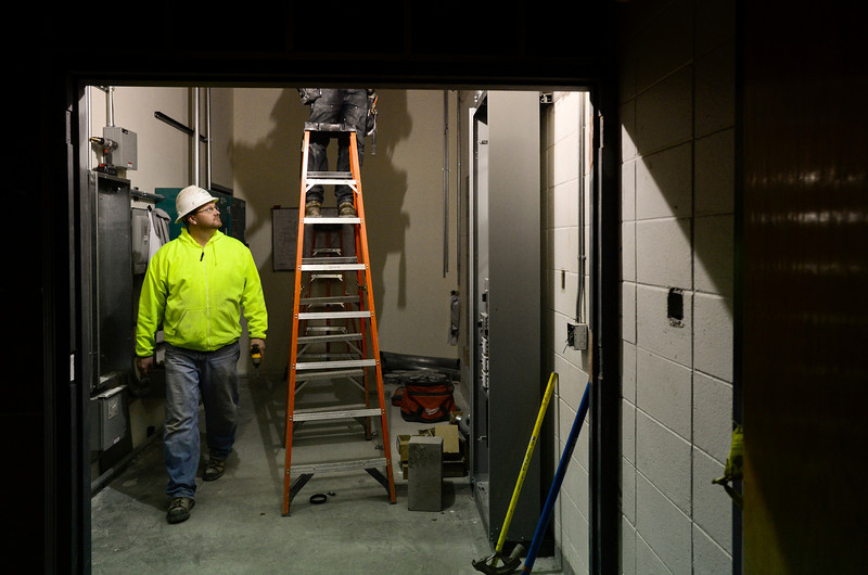 Project Foreman Jason Terry, of Malm Electrical Contractors LLC, supervises the progress of electrical work during construction on the new Thunder Valley K-8 school, Wednesday, Jan. 23, 2013, at the former Frederick Senior High School.<br /> (Matthew Jonas/Times-Call)