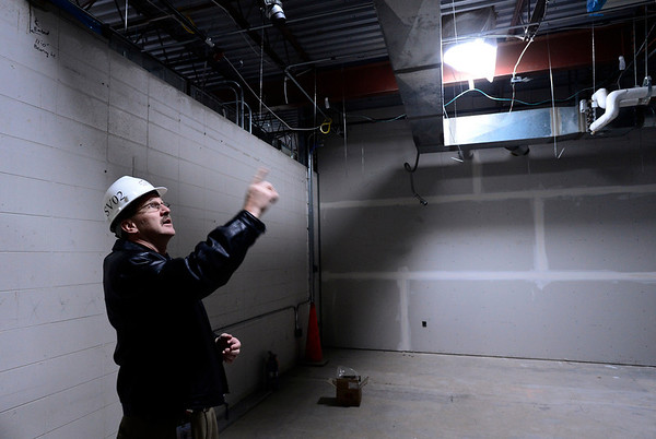 St. Vrain Valley Schools Director of Constrcution Brian Lamer points to a skylight that can be turned to follow the sun to bring natural light into a classroom throughout the day as construction continues on a new Thunder Valley K-8 school, Wednesday, Jan. 23, 2013, at the former Frederick Senior High School.<br /> (Matthew Jonas/Times-Call)
