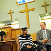 Pastor Corey Seulean, right, listens as Kendra Balentine speaks during an during an interview, Friday, Jan.11, 2013, at the Messiahville Baptist Church in Longmont.<br /> (Matthew Jonas/Times-Call)