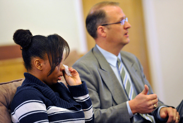 Kendra Balentine wipes tears from her eye as her pastor Corey Seulean speaks during an interview, Friday, Jan.11, 2013, at the Messiahville Baptist Church in Longmont.<br /> (Matthew Jonas/Times-Call)