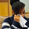 An emotional Kendra Balentine wipes tears from her eye as her pastor Corey Seulean (not pictured) speaks during an interview, Friday, Jan.11, 2013, at the Messiahville Baptist Church in Longmont.<br /> (Matthew Jonas/Times-Call)
