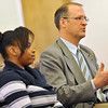 Kendra Balentine, left, listens as her pastor Corey Seulean, right, speaks during an interview, Friday, Jan.11, 2013, at the Messiahville Baptist Church in Longmont.<br /> (Matthew Jonas/Times-Call)