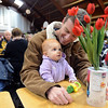 Matt Heron, of Louisville, plays with his nine-month-old daughter Amelia Heron after having breakfast at the 17th annual Oatmeal Festival in Lafayette Saturday morning Jan. 12, 2013. (Lewis Geyer/Times-Call)