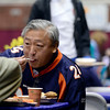 Tinyee Jue, of Westminster, wears his Broncos jersey while having breakfast at the 17th annual Oatmeal Festival in Lafayette Saturday morning Jan. 12, 2013. (Lewis Geyer/Times-Call)