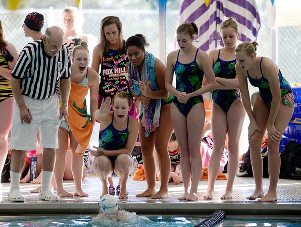 Members of the Longmont High School swim team cheer for a teammate during the All City Invitational swim meet at Centennial Pool Saturday, Jan. 19, 2013. (Lewis Geyer/Times-Call)