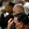 Jerry O'Brien prays during the Longmont Christian Men's Fellowship Wednesday morning Feb. 13, 2013 at the Longmont Senior Center. The group, which started in 1993, celebrated its 1,000th meeting. (Lewis Geyer/Times-Call)