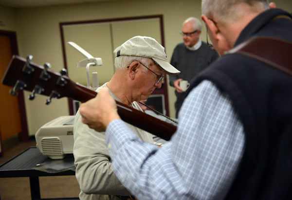 Clark Bell, left, and Mark Nikkel warm up before playing at the Longmont Christian Men's Fellowship Wednesday morning Feb. 13, 2013 at the Longmont Senior Center. The group, which started in 1993, celebrated its 1,000th meeting. (Lewis Geyer/Times-Call)