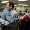 Don Carpenter, left, embraces Pastor Tom Hovestol at the start of the Longmont Christian Men's Fellowship Wednesday morning Feb. 13, 2013 at the Longmont Senior Center. The group, which started in 1993, celebrated its 1,000th meeting. Hovestol is the pastor at Calvary Church. (Lewis Geyer/Times-Call)
